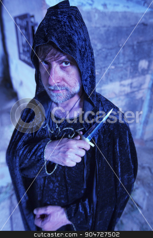 Serious Warlock with Dagger stock photo, Serious male warlock in cloak with dagger by Scott Griessel
