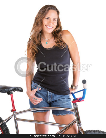 Cute Woman with Bike stock photo, Cute woman with bike and fingers in her pockets by Scott Griessel