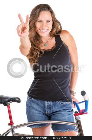 Girl Gesturing Victory with Her Bike stock photo, Isolated cute woman gesturing victor symbol with her bike by Scott Griessel