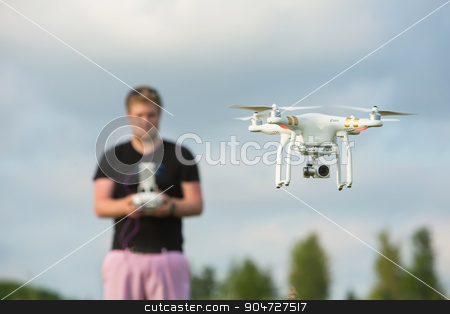 Adult Using Camera Drone stock photo, Single adult using remote control for a camera drone by Scott Griessel