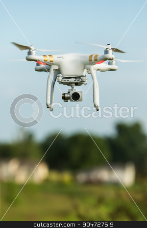 Flying Surveillance Drone  stock photo, Single surveillance drone flying in sky outdoors by Scott Griessel