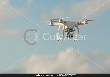 Flying Drone stock photo, Remote control drone in flight over sky by Scott Griessel