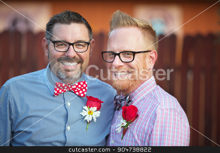 Handsome Smiling Gay Couple stock photo, Handsome smiling mature couple with eyeglasases standing outdoors by Scott Griessel