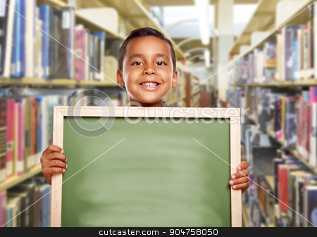 Smiling Hispanic Boy Holding Empty Chalk Board in Library stock photo, Happy Smiling Hispanic Boy Holding Empty Chalk Board in Library. by Andy Dean