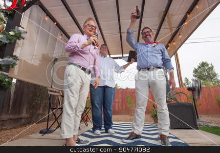 Gay Couple in Ceremony stock photo, Minister with male gay couple celebrating their marriage by Scott Griessel