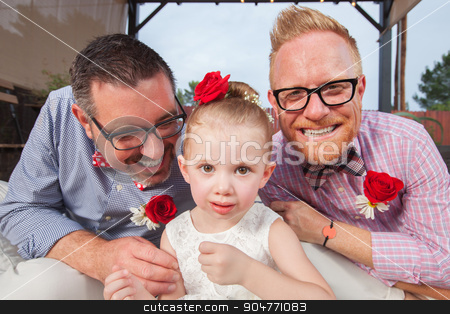 Gay Couple with Little Girl stock photo, Smiling gay couple with daughter sitting outdoors by Scott Griessel