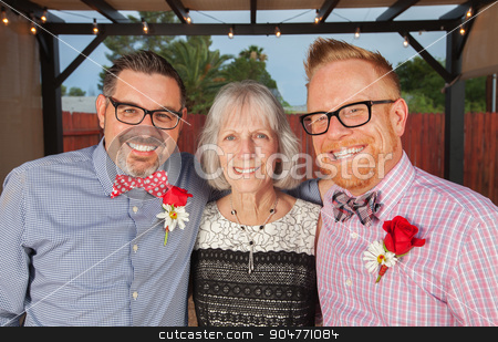Smiling Gay Men with Mother stock photo, Gay spouse with mother and partner in outdoor wedding by Scott Griessel