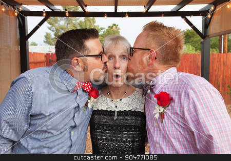 Woman Kissed by Two Men stock photo, Blushing senior woman kissed by two handsome men by Scott Griessel