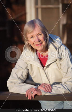 Senior Woman Leaning on Railing stock photo, Happy senior adult female leaning on railing outdoors by Scott Griessel
