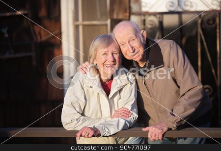 Close Couple Smiling stock photo, Happy Caucasian senior couple standing together outdoors by Scott Griessel