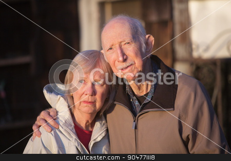 Serious Senior Couple stock photo, Serious European senior couple standing together outdoors by Scott Griessel