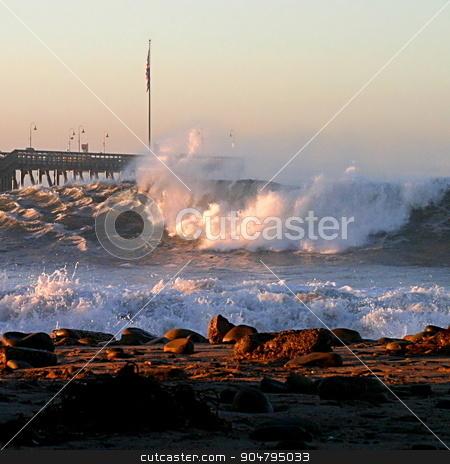 Ventura Sturm Pier stock photo, Ocean waves throughout at storm crashing into a Ventura pier. by Henrik Lehnerer