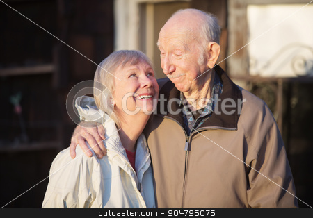 Couple Looking at Each Other stock photo, Cute European senior couple outdoors looking at each other by Scott Griessel