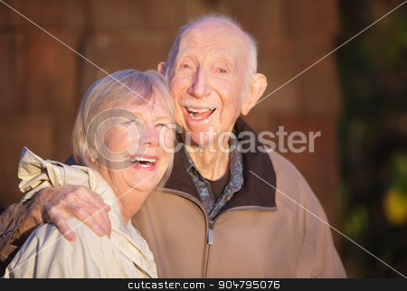 Couple Laughing Together stock photo, Cute Caucasian mature couple laughing together outdoors by Scott Griessel
