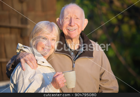 Confident Senior Couple stock photo, Confident white senior citizen couple outdoors with coffee by Scott Griessel