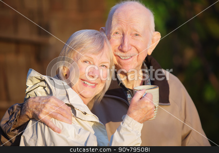 Happily Married Couple stock photo, Happily married senior couple outdoors with coffee outdoors by Scott Griessel