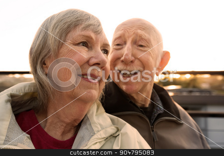 Man Teasing His Wife stock photo, Senior man teasing his wife while sitting outdoors by Scott Griessel