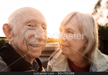 Woman Looking at Husband stock photo, Pretty woman looking at her grinning husband outdoors by Scott Griessel