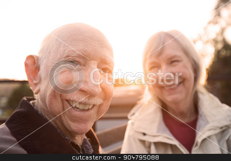 Couple Joking Together stock photo, Cute Caucasian couple sitting together outdoors by Scott Griessel