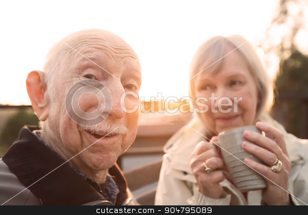 Embarrassed Man with Wife stock photo, European senior couple together outdoors making jokes by Scott Griessel