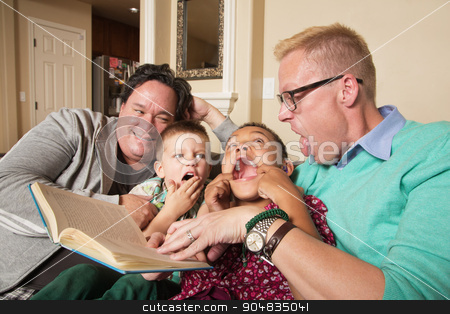 Gay Couple with Children stock photo, Diverse same sex parents with children reading together by Scott Griessel