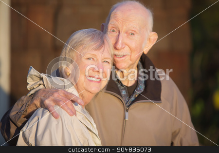Smiling Senior Couple Outdoors stock photo, Cute senior couple embracing each other outdoors by Scott Griessel