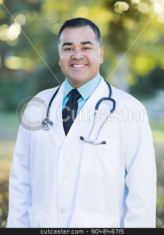 Hispanic Male Doctor Portrait Outdoors stock photo, Smiling Handsome Hispanic Male Doctor Portrait Outdoors. by Andy Dean