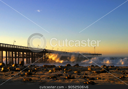 Ventura Pier Sturm Sunset stock photo, Ocean waves throughout at storm crashing into the Ventura pier. by Henrik Lehnerer