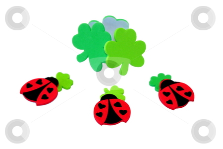 Lucky Ladybugs stock photo, Ladybugs with clovers for St. Patric's Day by Henrik Lehnerer