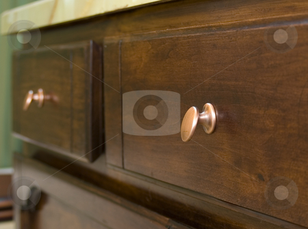 Bathroom drawers stock photo, Bathroom drawers with antique copper knobs by John Teeter