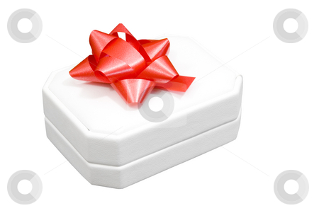 Jewelry box with red bow stock photo, Jewelry box with red bow on white background by John Teeter