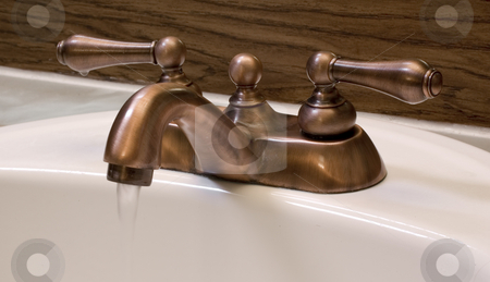 Running Faucet stock photo, Brushed copper faucet running water by John Teeter