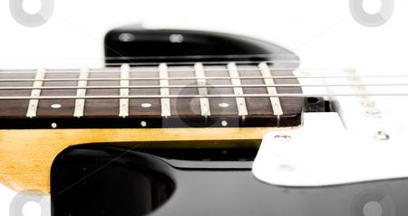 Guitar strings side stock photo, Guitar string on guitar by John Teeter