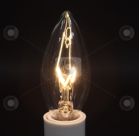 Candle bulb glowing stock photo, Candle bulb glowing on black by John Teeter