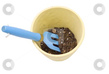 Rake in dirt with pot stock photo, Rake in dirt with pot by John Teeter