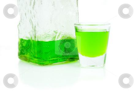 Full Shot glass stock photo, Full shot glass and bottle by John Teeter