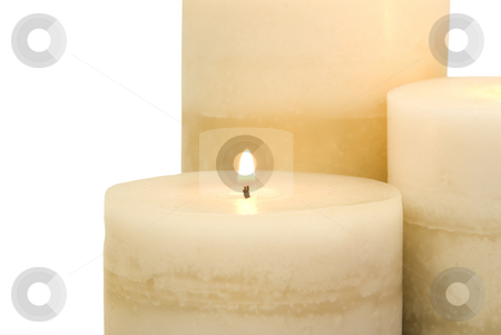 Close up of burning candle stock photo, Close up of burning candle on white by John Teeter