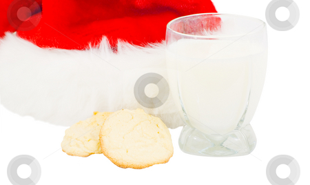 Santa hat with cookies and milk stock photo, Santa hat with cookies and milk isolated by John Teeter