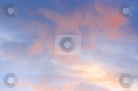 Pink clouds blue sky stock photo, Pink clouds on blue sky with light by John Teeter