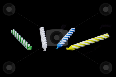 4 Birthday candles stock photo, 4 Birthday candles on black background by John Teeter