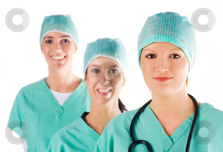 Nurses stock photo, Beautiful smiling young nurse with her team in the background by Tommy Maenhout