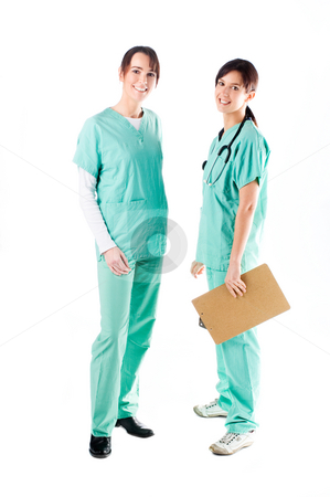 Nurses stock photo, Two young beautiful nurses discussing a patient's file by Tommy Maenhout