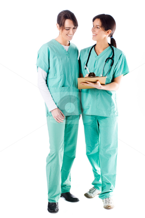 Nurses stock photo, 2 smiling nurses discussing a patient's file by Tommy Maenhout