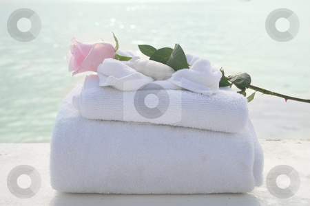 Spa towels stock photo, A tranquil spa setting with a beautiful pink rose. by Crystal Kirk