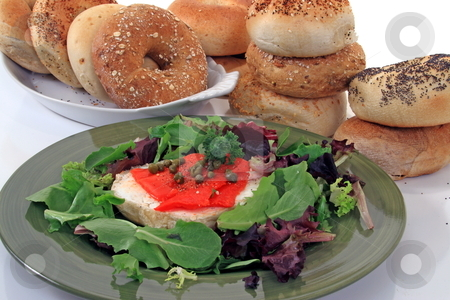 Bagels and lox stock photo, Breakfast dish of bagesl and lox with salad by Jack Schiffer