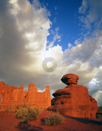Fisher Towers and Boulder stock photo, The Fisher Towers and a balanced rock boulder in Utah. by Mike Norton