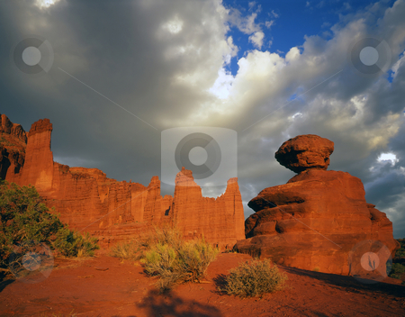 Fisher Towers and Boulder stock photo, The Fisher Towers and a balanced boulder in Utah. by Mike Norton