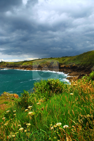 Atlantic coast in Brittany stock photo, Landscape of rocky Atlantic coast in Brittany France with stormy sky by Elena Elisseeva