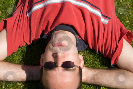 Relaxing Outside stock photo, A young male lying on the grass, relaxing outside by Richard Nelson