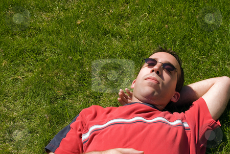 Male Sun Bathing stock photo, A young adult male lying in the grass by Richard Nelson